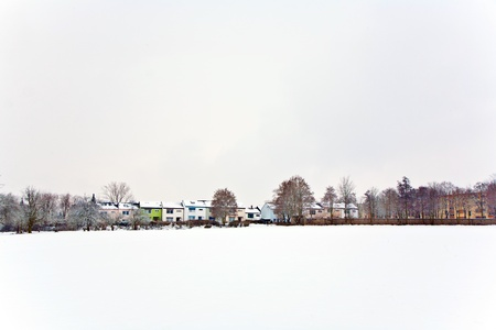settlement in winter landscape photo