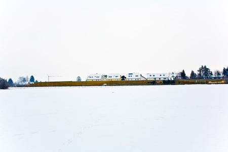 settlement in winter landscape photo