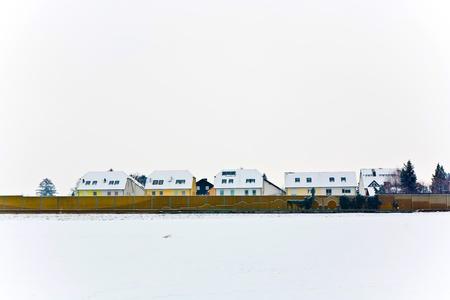 settlement in winter landscape Stock Photo - 10312104