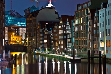 hamburg: old townhouses at the canal in Hamburg by night Stock Photo