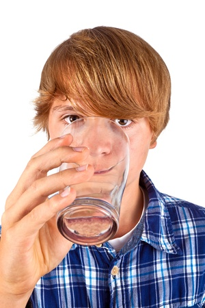 cute boy drinking water out of a glass photo