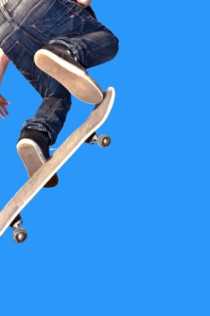 boy with skate board going airborne
