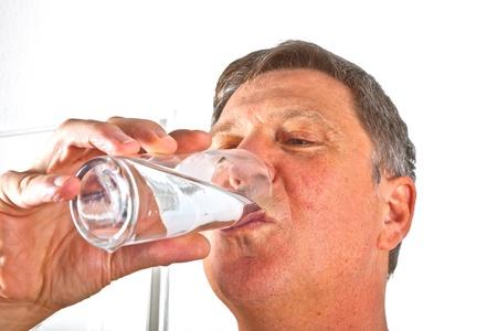 portrait of attractive man drinking water photo
