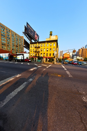 NEW YORK, USA - JULY 8: downtown streetview  at the east harbor side in late afternoon on July 8,2010 in New York, USA. Shadow of tourists waiting at the traffic light. Stock Photo - 10651142