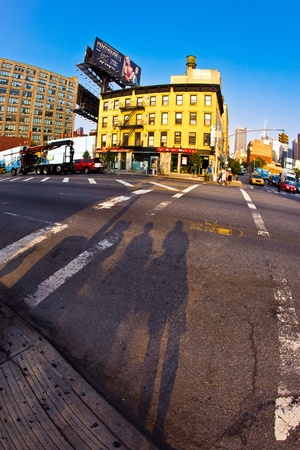 NEW YORK, USA - JULY 8: downtown streetview  at the east harbor side in late afternoon on July 8,2010 in New York, USA. Shadow of tourists waiting at the traffic light. Stock Photo - 10651146