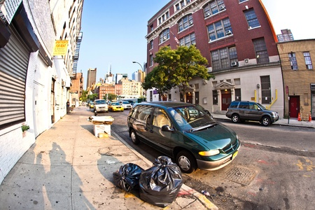 paveway: NEW YORK, USA - JULY 8: downtown streetview  at the east harbor side in late afternoon on July 8,2010 in New York, USA. Garbage placed at the paveway.