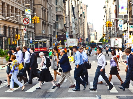 NEW YORK, USA – JULY 13: People hurry downtown Manhattan to their offices in early morning  on July 13,2010 in New York, USA.