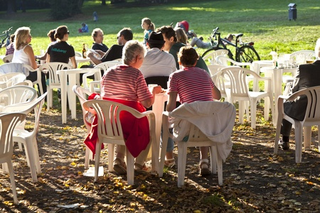 FRANKFURT, GERMANY -  SEP 25: people enjoy the last warm day in 2011 sitting outside in Grueneburg Park on September 25,2011 in Frankfurt, Germany. The park was finished in 1877 by the brothers  Siesmayer. Stock Photo - 10666733