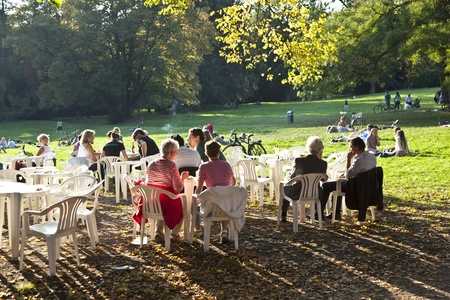 FRANKFURT, GERMANY -  SEP 25: people enjoy the last warm day in 2011 sitting outside in Grueneburg Park on September 25,2011 in Frankfurt, Germany. The park was finished in 1877 by the brothers  Siesmayer. Stock Photo - 10666754