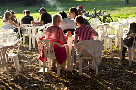 FRANKFURT, GERMANY -  SEP 25: people enjoy the last warm day in 2011 sitting outside in Grueneburg Park on September 25,2011 in Frankfurt, Germany. The park was finished in 1877 by the brothers  Siesmayer. Stock Photo - 10666742