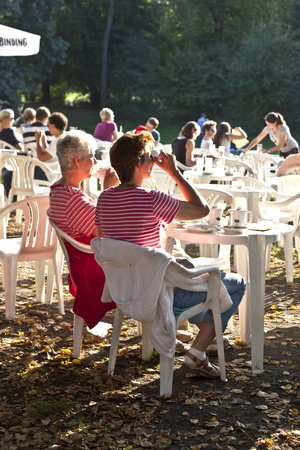 FRANKFURT, GERMANY -  SEP 25: people enjoy the last warm day in 2011 sitting outside in Grueneburg Park on September 25,2011 in Frankfurt, Germany. The park was finished in 1877 by the brothers  Siesmayer. Stock Photo - 10666734