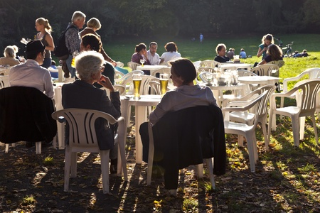 FRANKFURT, GERMANY -  SEP 25: people enjoy the last warm day in 2011 sitting outside in Grueneburg Park on September 25,2011 in Frankfurt, Germany. The park was finished in 1877 by the brothers  Siesmayer. Stock Photo - 10666741
