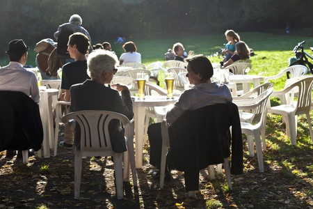 FRANKFURT, GERMANY -  SEP 25: people enjoy the last warm day in 2011 sitting outside in Grueneburg Park on September 25,2011 in Frankfurt, Germany. The park was finished in 1877 by the brothers  Siesmayer. Stock Photo - 10666724