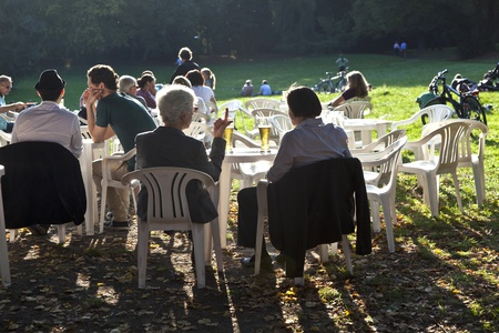 FRANKFURT, GERMANY -  SEP 25: people enjoy the last warm day in 2011 sitting outside in Grueneburg Park on September 25,2011 in Frankfurt, Germany. The park was finished in 1877 by the brothers  Siesmayer. Stock Photo - 10666737