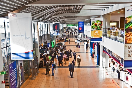 HAMBURG, GERMANY SEP 28: People hurry to the gate in Terminal 2 on SEP 28, 2011 in Hamburg, Germany. Terminal 2 was completed in 1993 and houses Lufthansa and other Star Alliance partners.