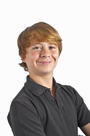 smart little boy smiling on white background photo
