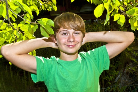 cute smart boy in the garden under the  tree Stock Photo - 10741742