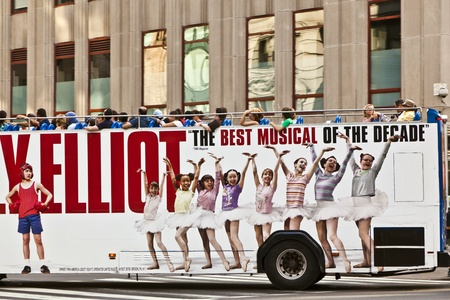 elliot: NEW YORK, USA - JULY 11: tourists in an upperdecker city sights bus on July 11, 2010 New York, USA.  ADs on the bus for  Broadway production Billy Elliot opened at the Imperial Theatre 1. Oct 2008.
