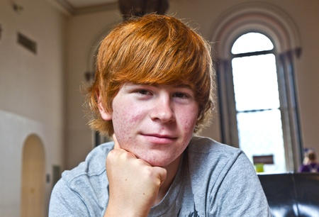 tourist spots: portrait of cute boy with red hair
