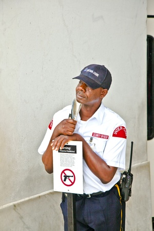 WASHINGTON, DC - JUL 7: security officer pays attention that visitors follow the rules  at the Lincoln Memorial on July 7,2011 in Washington DC. All firearms are prohibited at that place. Stock Photo - 10752772