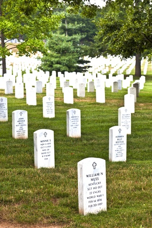 a memorial to fallen soldiers: WASHINGTON DC - JUL 15: Gravestones on Arlington National Cemetery on July 15,2010 in Washington DC, USA. Headstones mark soldier graves who died in every conflict from Revolution to Sept 11. Editorial