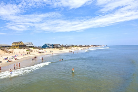 nags: NAGS HEAD, USA - JUL 18: people enjoy bathing on July 18,2010 in Nags Head, USA. Established in the 1830s as first tourist colony, the first oceanfront cottage was built here in 1855 by Dr. W.G. Pool.
