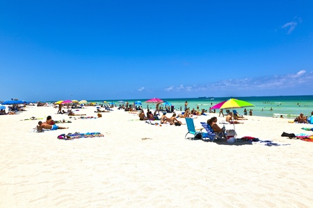 sunny south: MIAMI BEACH, USA - JULY 27: People enyoy the beach and swimming in South Beach on July 27,2010 in Miami Beach, Florida. This area was the first section of Miami Beach to be developed, starting in the 1910s.