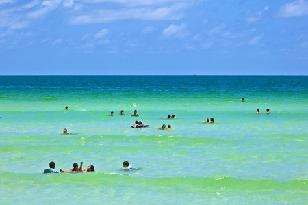 MIAMI BEACH, USA - JULY 27: People enyoy the beach and swimming in South Beach on July 27,2010 in Miami Beach, Florida. This area was the first section of Miami Beach to be developed, starting in the 1910s.