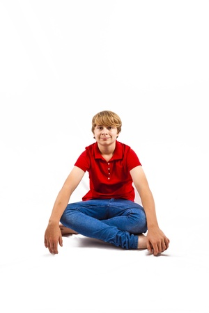 tailor seat: cute boy sitting on the floor