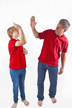 father and son giving high five Stock Photo - 10836911