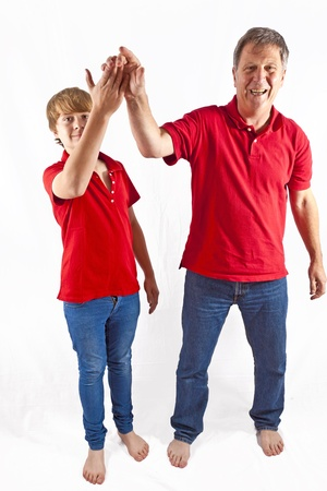 father and son giving high five Stock Photo - 10836912