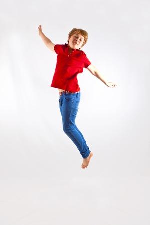 cute boy jumping in the air photo