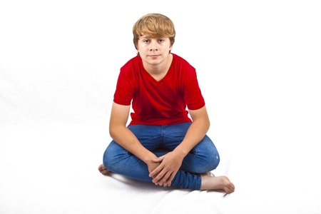 smart boy with red shirt sitting in tailor seat at the floor photo