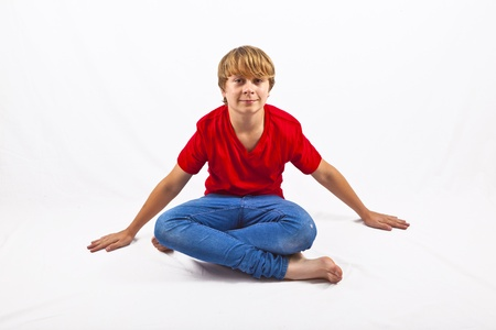 tailor seat: smart boy with red shirt sitting in tailor seat at the floor
