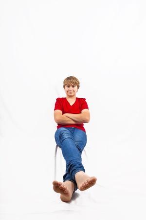 smart boy in studio isolated on white photo