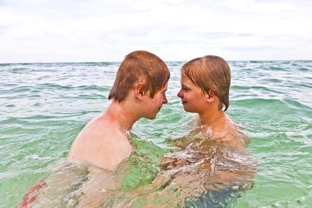 boys having fun in the beautiful clear sea Stock Photo - 10888376