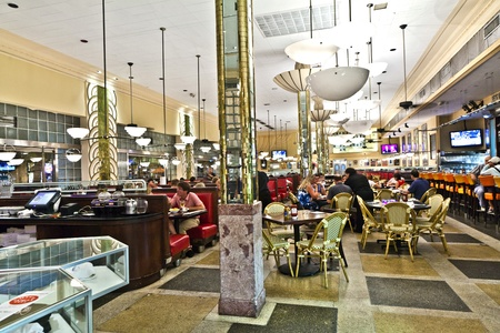MIAMI BEACH, USA - August 02: eating in Jerrys famous Deli on August 02,2010 in Miami Beach, USA. The ART deco place was built and designed in 1940 by Henry Hohauser.