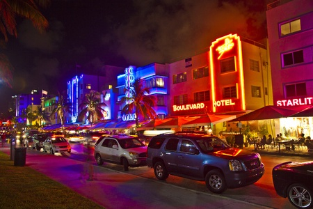 attractions: MIAMI BEACH, USA - August 02: Night view at Ocean drive on August 02,2010 in Miami Beach, Florida. Art Deco Night-Life in South Beach is one of the main tourist attractions in Miami.