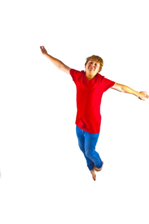 smart boy with red shirt jumping in the air photo