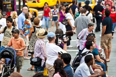 times square: NEW YORK CITY - JUL 8: people take photos at Times Square on July 8, 2010 in , New York City.  Times Square is visited by over 26 million people a year. Editorial