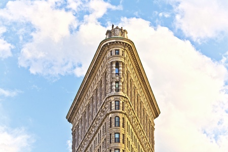 NEW YORK CITY – JULY 12: Facade of the Flatiron building  with iron statue of Man on the roof on July 12,2010 in New York City. Stock Photo - 10938379