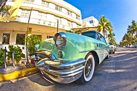 midday: MIAMI BEACH, USA - AUGUST 02: midday view at Ocean drive on August 02,2010 in Miami Beach, Florida. The old Buick from 1954 stands as attraction in front of famous Avalon Hotel. Editorial