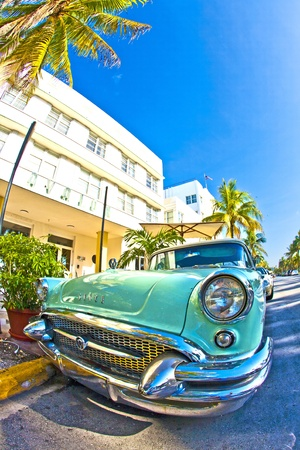 MIAMI BEACH, USA - AUGUST 02: midday view at Ocean drive on August 02,2010 in Miami Beach, Florida. The old Buick from 1954 stands as attraction in front of famous Avalon Hotel.