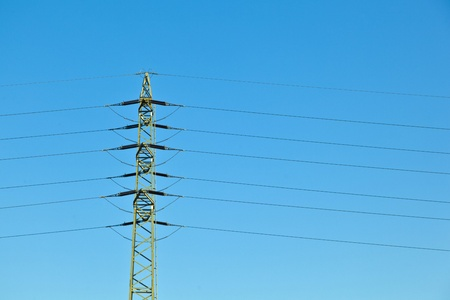 electrical tower in field under blue sky photo