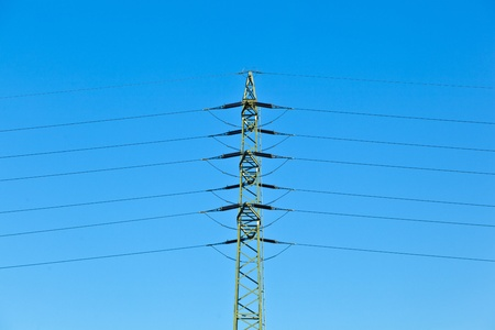 electrical tower in field under blue sky Stock Photo - 11023929