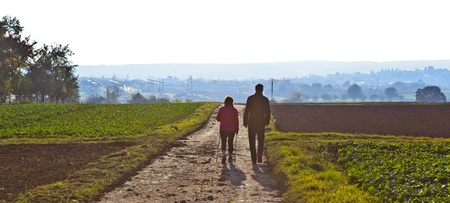 couple walking on a pathway photo