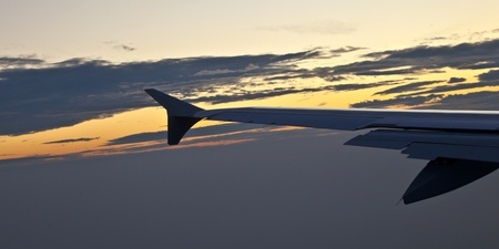 wing of aircraft in the sky photo