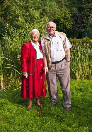 elder tree: elderly couple sitting hand in hand in their garden
