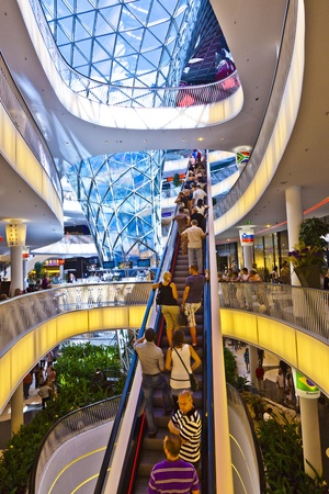 view of a staircase in a shop: FRANKFURT, GERMANY - AUGUST 21: people visit and shop inside the myZeil center on August 21,2010 in Frankfurt, Germany. The modern building by architect Fuksas was inaugurated in 2009.