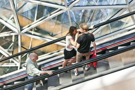 view of a staircase in a shop: FRANKFURT, GERMANY - AUGUST 21: people on the long moving staircase visit myZeil center on August 21,2010 in Frankfurt, Germany. The modern building by architect Fuksas was inaugurated in 2009. Editorial